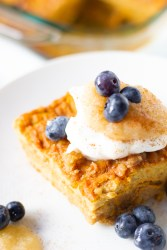 Pumpkin French toast bake topped with Greek yogurt, applesauce, cinnamon and blueberries
