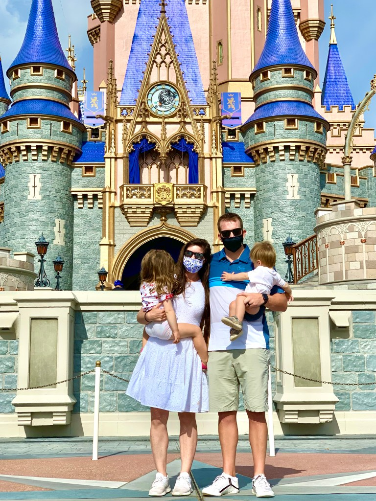 Family in front of Magic Kingdom castle 2021