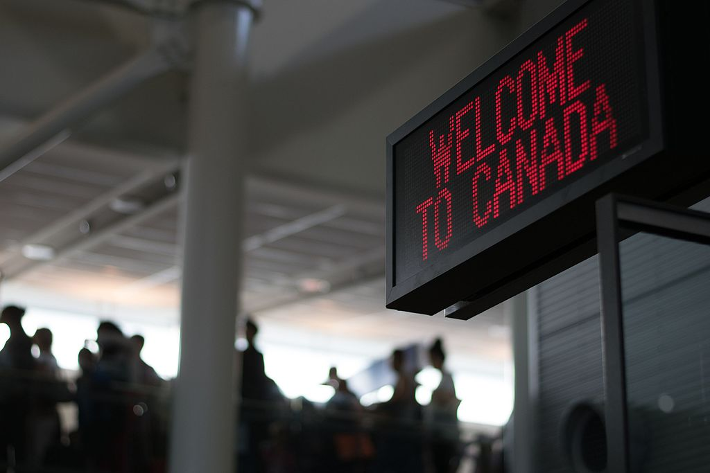 Montreal Trudeau airport welcome to Canada sign