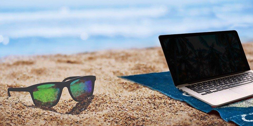 beach laptop workcation