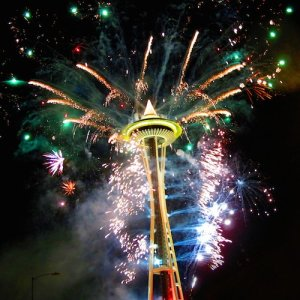 Seattle's Space Needle lit up by fireworks on New Year's Eve.