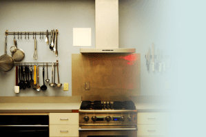 The stovetop, counter and hanging utensils of the Stahancyk, Kent and Hook Portland office kitchen.
