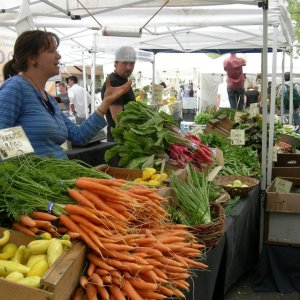Carrots and other vegetables for sale at Ballard Sunday Farmers' Market, Ballard Avenue (historic district), Ballard, Seattle, Washington.