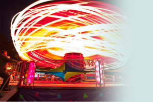 A long exposure of a spinning carnival ride.