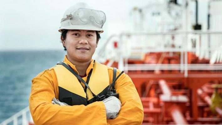 Asian ship crew on oil tanker