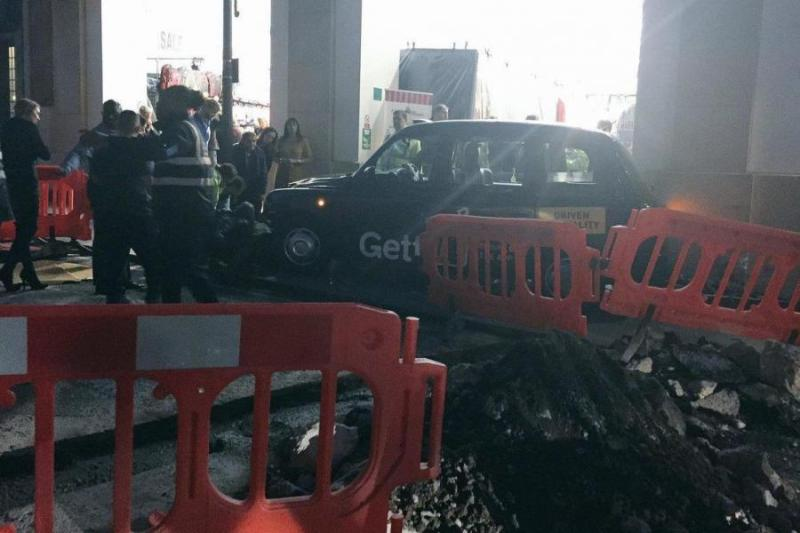 Four people have been injured after a black cab mounted the pavement and hit pedestrians at a busy tourist hotspot in central London.