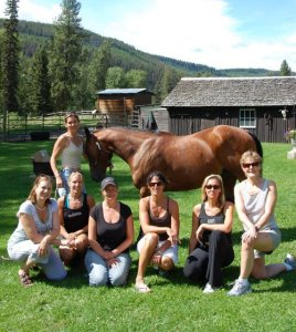 group of women with a horse