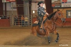 Carla Webb doing sliding stop in reining event