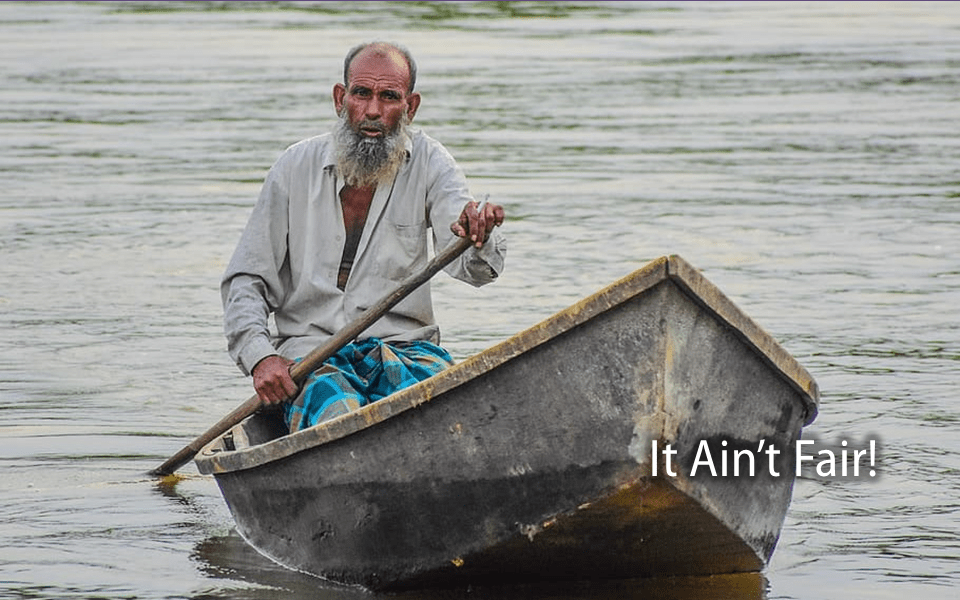 Old man alone in a boat