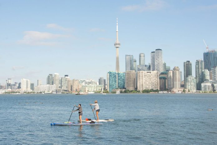Toronto skyline Shoreline A Greener Future stand up paddling