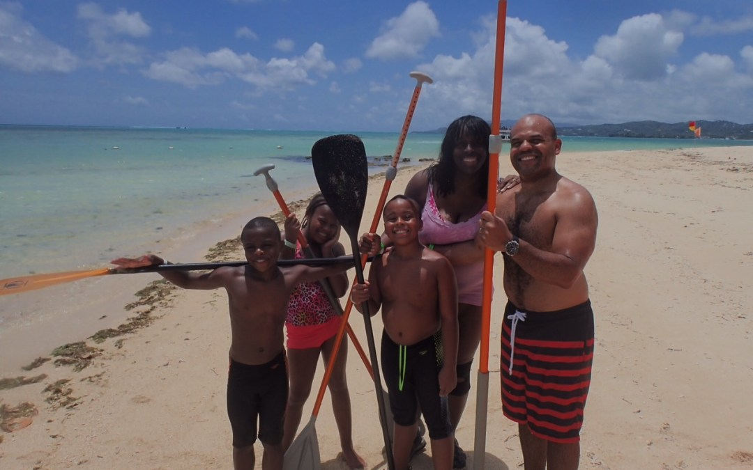 Family learns to Stand Up Paddle in Tobago