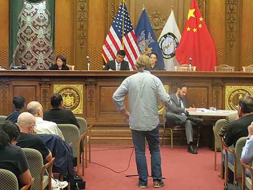 Adam Armstrong standing before the EDC representatives
