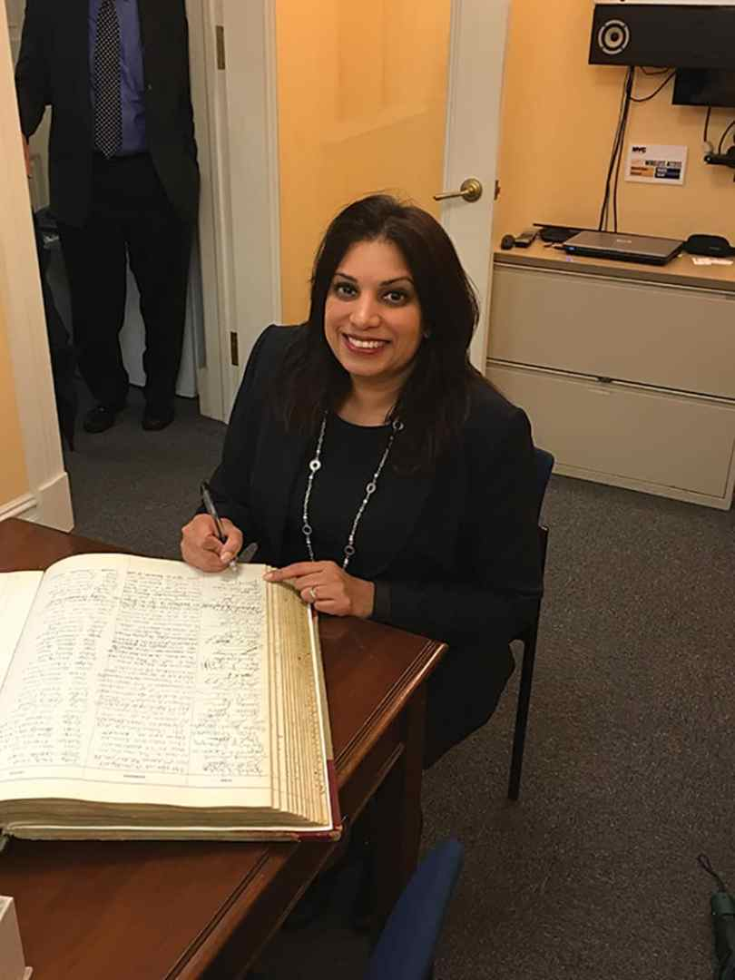 Karen Gopee signing the judges book at City Hall. (photo courtesy Gopee)