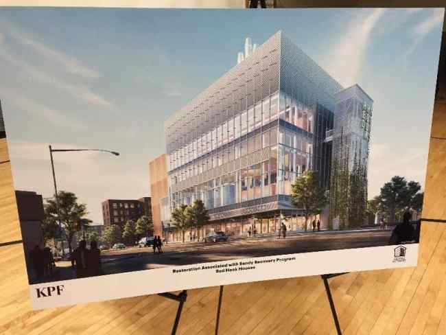 The rendering of the final plan for the heating plant on Columbia Street and West 9th was on display at the meeting.