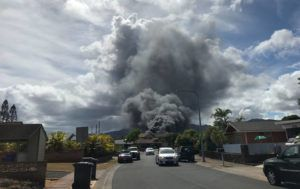DENNIS ODA / DODA@STARADVERTISER.COM Honolulu firefighters are responding to a fire that is creating a large plume of black smoke in Mililani.