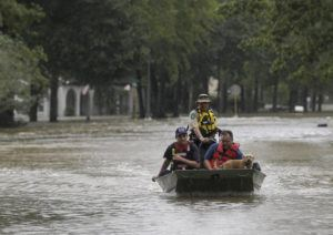 GODOFREDO A. VASQUEZ/HOUSTON CHRONICLE VIA AP                                 First responders with the Harris County Sheriff's Office, Texas Game Warden, and Huffman Fire Department rescued people from flooded homes in the Lochshire neighborhood in Huffman, Texas. The Luce Bayou overflowed due to the heavy rain during Tropical Storm Imelda.