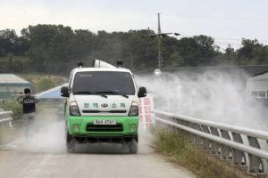 ASSOCIATED PRESS                                 Disinfectant solution is sprayed from a vehicle as a precaution against African swine fever near a pig farm in Paju, South Korea. South Korea said Friday that it is investigating two more suspected cases of African swine fever from farms near its border with North Korea, as fears grow over the spread of the illness that has decimated pig herds across Asia.
