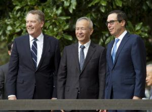 ASSOCIATED PRESS                                 Chinese Vice Premier Liu He — accompanied by U.S. Trade Representative Robert Lighthizer, left, and Treasury Secretary Steven Mnuchin — greeted the media before a minister-level trade meetings at the Office of the United States Trade Representative in Washington, Thursday.