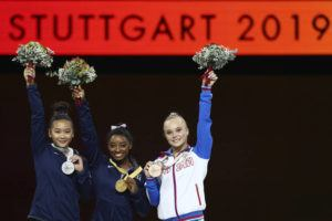 ASSOCIATED PRESS Simone Biles of the United States, center and gold medal, Sunisa Lee of the United States, left and silver medal, and Angelina Melnikova of Russia, right and bronze medal, celebrate during the award ceremony for the floor exercise in the women's apparatus finals at the Gymnastics World Championships in Stuttgart, Germany, today.