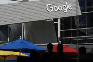 ASSOCIATED PRESS                                 People walked by a Google sign, Sept. 24, on the campus in Mountain View, Calif. Alphabet's board of directors is investigating claims of sexual misconduct made against executives and how the company handled the allegations.