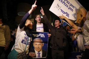 ASSOCIATED PRESS                                 Supporters of Israeli Prime Minister Benjamin Netanyahu gathered outside his residence in Jerusalem on Thursday. Israel's attorney general charged Netanyahu with fraud, breach of trust and accepting bribes in three different scandals. It was the first time a sitting Israeli prime minister had been charged with a crime.