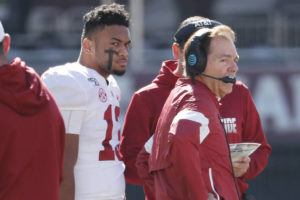 ASSOCIATED PRESS                                 Alabama quarterback Tua Tagovailoa listens to instructions from head coach Nick Saban during a timeout against Mississippi State on Saturday.