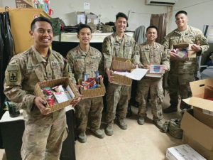 COURTESY PHOTO                                 Hawaii National Guard soldiers Sgt. Bradley Padama-Kinere, left, Staff Sgt. Paul Calamayan, 2nd Lt. Francisco Barba, Spc. Andrew Octubre and Spc. Shaun Dela Calzada show care packages they received. They are with the C-RAM mission in Uruzgan province in Afghanistan.