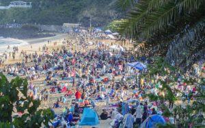 DENNIS ODA / 2016                                 Surfing fans pack Waimea Bay in 2016 for the Eddie Aikau Big Wave Invitational.