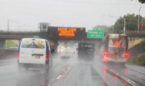 "DENNIS ODA / DODA@STARADVERTISER.COM                                 A sign today warns drivers, ""Drive Like Santa's Watching."""