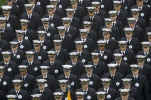 ASSOCIATED PRESS                                 Navy midshipmen marched onto field ahead of a football game between the Army and the Navy, Dec. 14, in Philadelphia. A military investigation found that hand gestures used by cadets and midshipmen during the Army-Navy game broadcast had nothing to do with white supremacy.