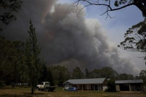 "ASSOCIATED PRESS A home stands as smoke from the Grose Valley fire rises in the distance in Bilpin, west of Sydney, Saturday, Dec. 21, 2019. Australia's most populous state has been paralyzed by ""catastrophic"" fire conditions Saturday amid souring temperatures as wildfires also ravaged the country's southeast."