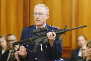 ASSOCIATED PRESS / APRIL 2                                 Police acting superintendent Mike McIlraith shows New Zealand lawmakers an AR-15 style rifle similar to one of the weapons a gunman used to slaughter 51 worshippers at two Christchurch mosques, in Wellington, New Zealand. New Zealand authorities said today their country will be a safer place after gun owners handed in more than 50,000 guns during a buyback program after the government banned assault weapons. But critics say the process was flawed and many owners have illegally stashed their guns.