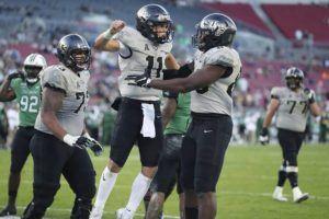 ORLANDO SENTINEL VIA AP                                 Central Florida quarterback Dillon Gabriel celebrates after a touchdown against Marshall during the Gasparilla Bowl.