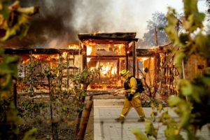 ASSOCIATED PRESS                                 Woodbridge firefighter Joe Zurilgen passes a burning home as the Kincade Fire rages in Healdsburg, Calif., Oct. 27. California's massive property insurance market is feeling the effects of three straight years of damaging wildfires.