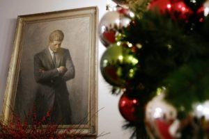 ASSOCIATED PRESS / 2006                                 A portrait of former President John F. Kennedy, framed by Christmas decorations, hangs in the White House in Washington. A copy of Kennedy's 1961 letter reassuring an 8-year-old Michigan girl, who had written him concerned that Santa would be killed if Russia tested a nuclear bomb at the North Pole, is being featured at the JFK Presidential Library and Museum in Boston.