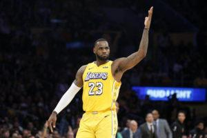 ASSOCIATED PRESS                                 Los Angeles Lakers' LeBron James reacts after making a 3-pointer during the second half of the team's NBA basketball game against the Los Angeles Clippers on Dec. 25 in Los Angeles. The Clippers won 111-106.