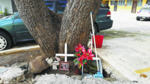 ROB SHIKINA / RSHIKINA@STARADVERTISER.COM                                 A small memorial is seen Sunday near where Gloria Takaoka was fatally shot next to her Green Street apartment in Makiki. Ernest Romero, a neighbor, was charged with murder today in connection with the shooting.