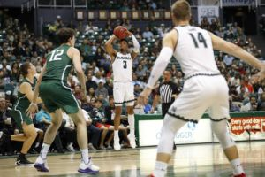 Cindy Ellen Russell / crussell@staradvertiser.com                                 Hawaii's Eddie Stansberry (3) rose for a 3-point shot during the first half against the Portland State in November.