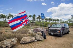 DENNIS ODA / DODA@STARADVERTISER.COM                                 A Hawaiian flag flies upside down at Oneula Beach Park in June. The city says it is closing the park overnight to help revitalize the Ewa park.