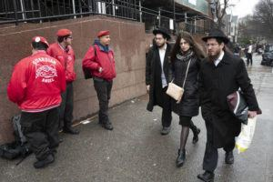 ASSOCIATED PRESS                                 Members of the Guardian Angels, left, a volunteer safety patrol organization, stand in front of the Chabad Lubavitch World Headquarters, Monday, Dec. 30, 2019 in the Brooklyn borough of New York. The Guardian Angels and police have increased patrols in the Crown Heights neighborhood following an anti-Semitic attack on a Hanukkah celebration in Monsey, N.Y.