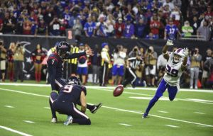 ASSOCIATED PRESS Houston Texans kicker Ka'imi Fairbairn kicks a game-winning 28-yard field goal as Buffalo Bills cornerback Kevin Johnson tries to block the kick during overtime.
