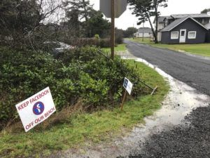 ASSOCIATED PRESS                                 A sign expressing opposition to a plan by Facebook to build a landing spot for a submarine cable connecting America with Asia stood on property in the tiny community of Tierra del Mar, Ore., Wednesday.