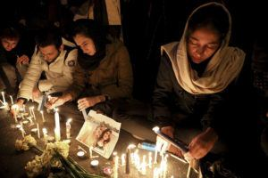 ASSOCIATED PRESS                                 People gather for a candlelight vigil to remember the victims of the Ukraine plane crash at the gate of Amri Kabir University in Tehran, Iran.