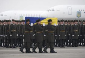 COURTESY UKRAINIAN PRESIDENTIAL PRESS OFFICE                                 Honor guards carry a coffin of the one of the eleven Ukrainian victims of a plane that crashed on the outskirts of Tehran on Jan. 8, during a memorial ceremony at Borispil international airport outside Kyiv, Ukraine, on Jan. 19.