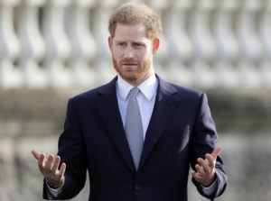 ASSOCIATED PRESS                                 Britain's Prince Harry gestures in the gardens of Buckingham Palace in London on Thursday.