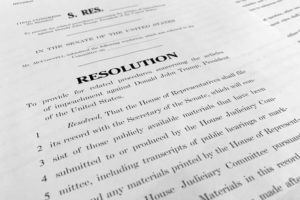 ASSOCIATED PRESS                                 A copy of a Senate draft resolution to be offered by Senate Majority Leader Mitch McConnell, R-Ky., regarding the procedures during the impeachment trial of President Donald Trump in the U.S. Senate is photographed in Washington.