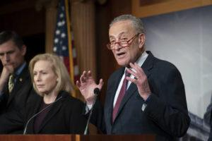 ASSOCIATED PRESS                                 Senate Minority Leader Chuck Schumer, D-N.Y., joined from left by Sen. Martin Heinrich, D-N.M., and Sen. Kirsten Gillibrand, D-N.Y., talked to reporters about the impeachment trial of President Donald Trump on charges of abuse of power and obstruction of Congress, in Washington, today.