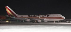 BILL ROTH/ANCHORAGE DAILY NEWS VIA ASSOCIATED PRESS                                 An airplane, background, carrying U.S. citizens being evacuated from Wuhan, China, made a refueling stop at the north terminal at Ted Stevens Anchorage International Airport in Anchorage, Alaska, Tuesday evening.