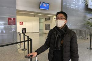 ASSOCIATED PRESS                                 Bill Chen stood outside of customs, Wednesday, at San Francisco International Airport after arriving on a flight from Shanghai, where he was conducting business and visiting family over the Lunar New Year holiday. Chen said his temperature was quickly screened at the Shanghai airport before he departed.