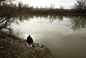 ASSOCIATED PRESS                                 A fisherman sits along the slough today where the body of an infant, Nikko Lee Perez, was discovered in Yolo County in 2007, near Woodland, Calif. Paul Perez, a California father about to be freed from prison, has been taken into custody in connection with the decades-old killings of five of his infant children including Nikko in a case a sheriff said has haunted his agency for years.